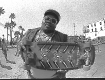 Darren 'Buffy' Robinson (RIP) of the Fat Boys in Venice holding my board circa 1984.