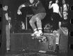 unknown skater jumping off the stage after a gig at CBGB's circa 1986