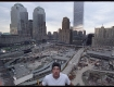 Aaron Hawkins overlooking 9/11 Ground Zero in New York, for his music project